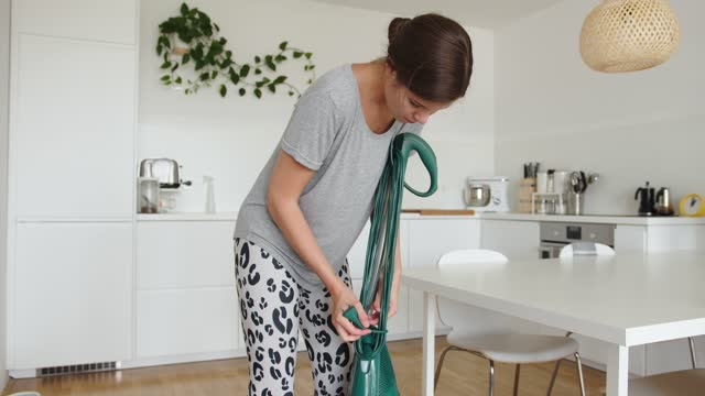 woman wrapping the electric cable on vacuum cleaner - wooden floor stock videos & royalty-free footage