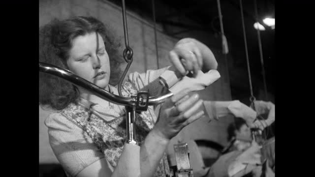 woman wraps and prepares bicycle for export in factory; 1952 - 1952 stock videos & royalty-free footage