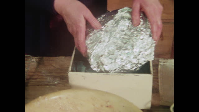 cu woman wraps fruitcake in silver foil and puts in tin - christmas gift stock videos & royalty-free footage
