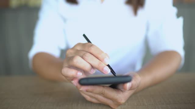 Woman write in smart phone