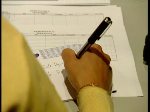 woman writes note and tears it from notepad spain - pen stock videos & royalty-free footage