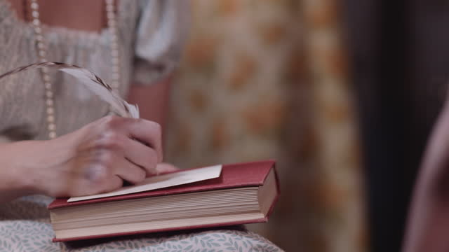 woman writes with quill in period costume. - author stock videos & royalty-free footage