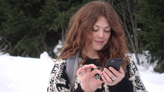 woman writing a text message on a hike - redhead stock videos & royalty-free footage