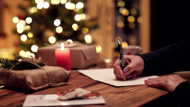woman writing greeting christmas postcard. - message stock videos & royalty-free footage