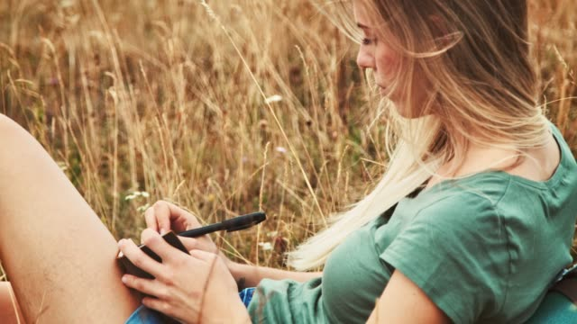 woman writing in diary while relaxing on field - diary stock videos & royalty-free footage