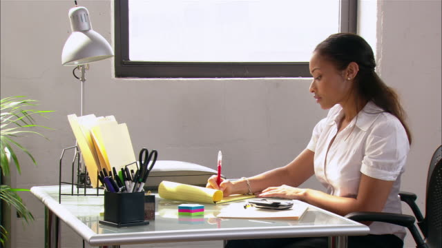 woman writing on notepad at desk / new york city - electronic organiser stock videos & royalty-free footage