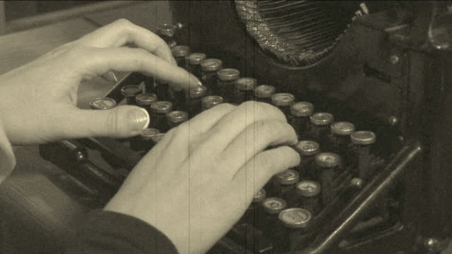 woman writing to a very old typewriter - black and white stock videos & royalty-free footage