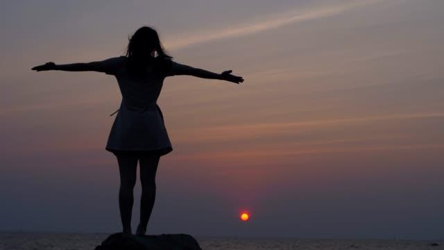 Woman Yoga at sunset