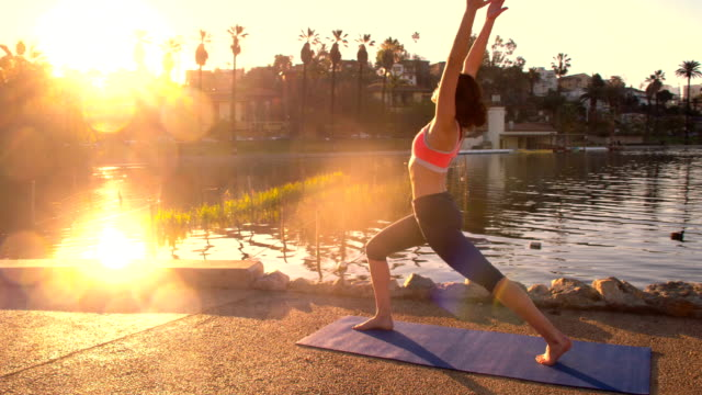 woman yoga park morning - stretching stock videos & royalty-free footage