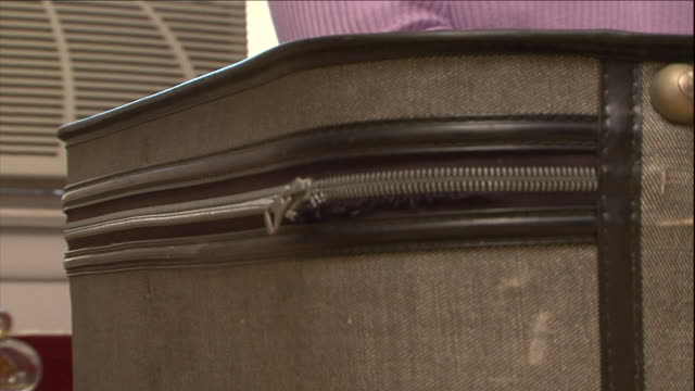 a woman zips a full suitcase. - packing stock videos & royalty-free footage