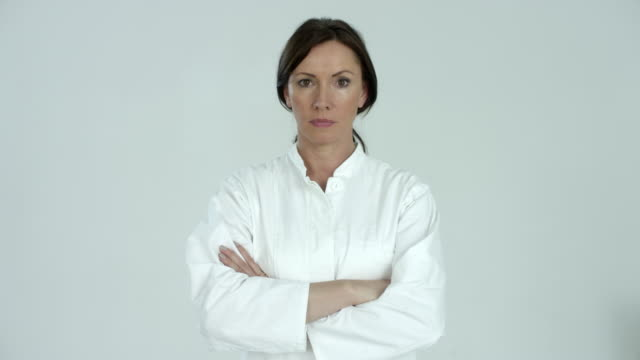 woman/female/doctor in white gown (45 years old) - multiple intense expressions - confidential/strict look