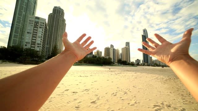 woman's arms stretch towards surfer's paradise skyline - hope stock videos & royalty-free footage
