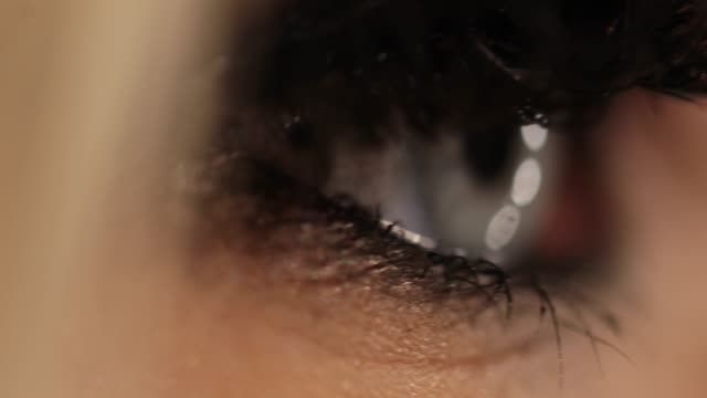 woman's blue eye - extreme close up stock videos & royalty-free footage