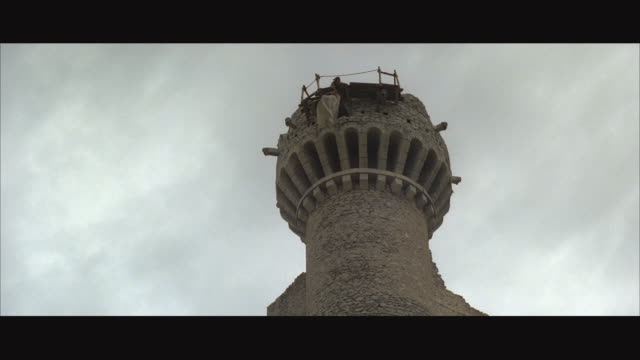 ws woman's body hanging on abbey or monastery tower - abbey stock videos & royalty-free footage