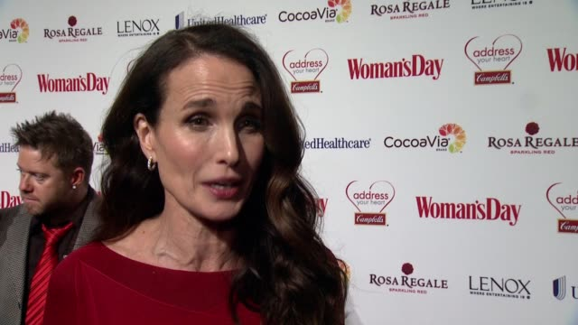 woman's day red dress awards red carpet benefitting go red for women at 10 columbus circle on february 10, 2015 in new york city. - elvis costello stock-videos und b-roll-filmmaterial