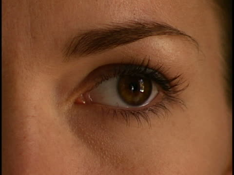 woman's eye close-up - brown hair stock videos & royalty-free footage