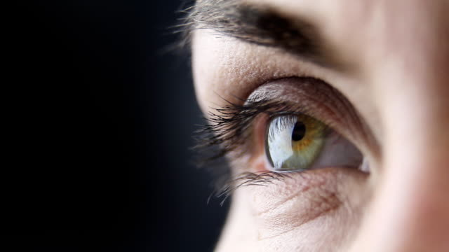 woman's eye - macro - blinking stock videos & royalty-free footage