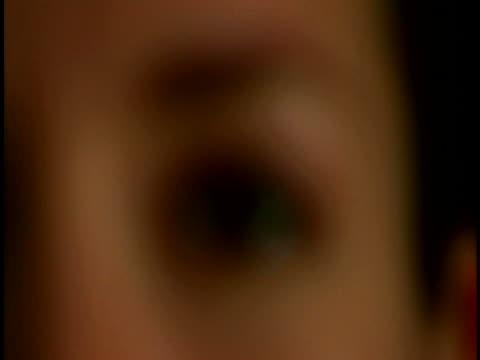 woman's eye - sideways glance stock videos & royalty-free footage