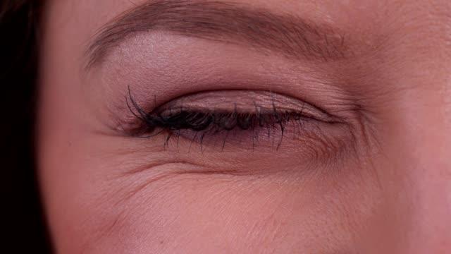 woman's eye winking - winking stock videos & royalty-free footage