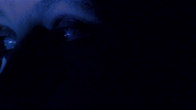 ecu woman's face under blue light - verängstigt stock-videos und b-roll-filmmaterial