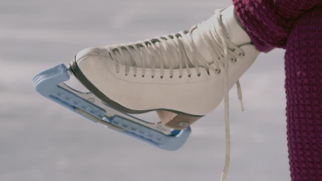cu woman's feet as she ties ice skates and skates away/ long island, ny - leg warmers stock videos & royalty-free footage