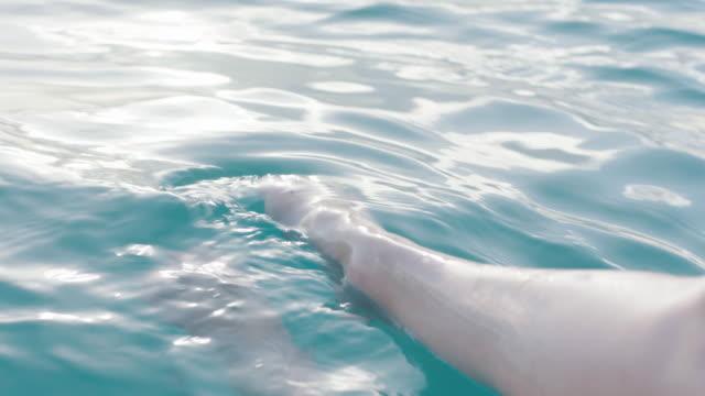 woman's feet in the sea - 若い女性だけ点の映像素材/bロール