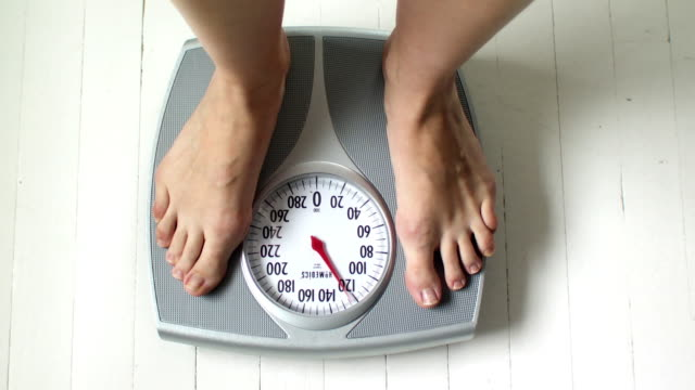 cu ha woman's feet on bathroom scale, scarborough, new york, usa - weight scale stock videos & royalty-free footage