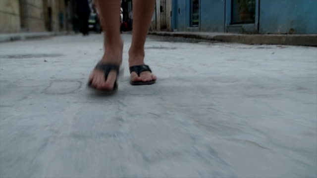 womans feet walking the streets of cuba - flip flop stock videos and b-roll footage