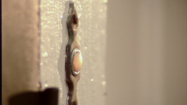 a woman's finger pushes a doorbell. - schieben stock-videos und b-roll-filmmaterial