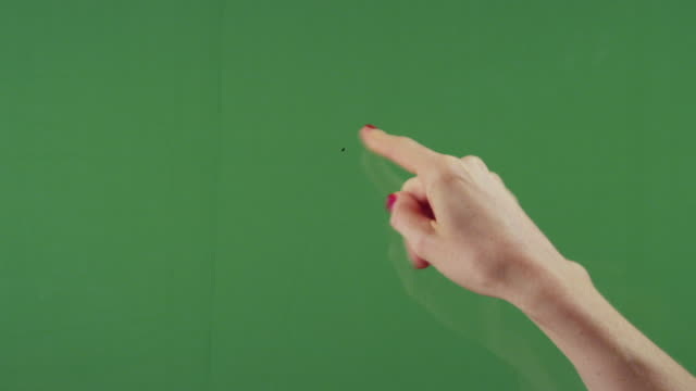 cu woman's finger swiping down over green screen - keyable stock videos & royalty-free footage