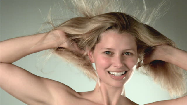 cu slo mo woman's hair blowing, portrait / san francisco, california, usa    - gray background stock videos & royalty-free footage