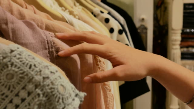 woman's hand choose a clothing
