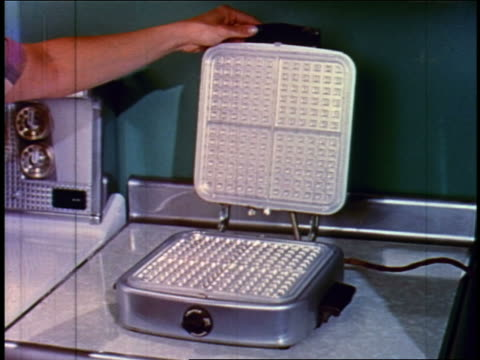 1955 woman's hand closing waffle iron on counter near oven - 1955 stock videos & royalty-free footage