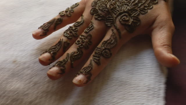 cu zi woman's hand having henna designs applied/ morocco - squirting woman stock videos and b-roll footage