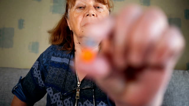 woman's hand holds a pill - anti depressant stock videos & royalty-free footage