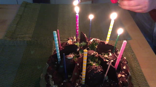 woman's hand lighting candles on birthday cake - birthday candle stock videos & royalty-free footage
