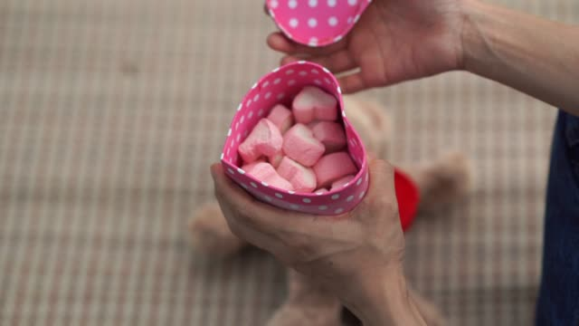 woman's hand open gift box , pink marshmallow , heart shape - sweet food stock videos & royalty-free footage