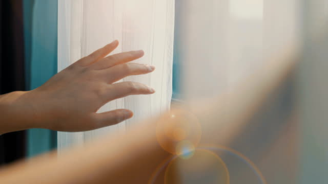 woman's hand opening curtains - window stock videos & royalty-free footage