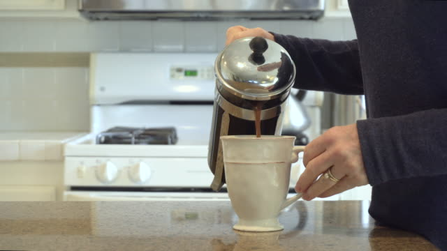 woman's hand pouring a cup of coffee - pianale da cucina video stock e b–roll