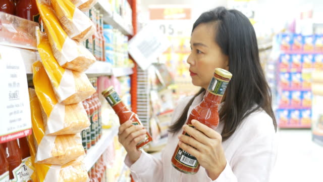 woman's hand shopping dairy product in supermarket - sauce stock videos & royalty-free footage