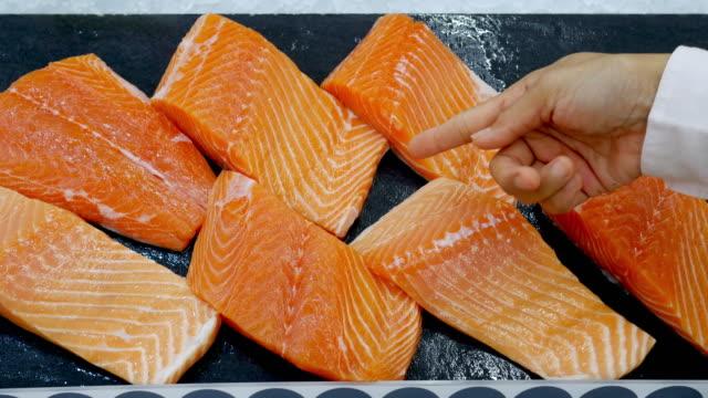 woman's hand shopping fresh organic food in supermarket , fish