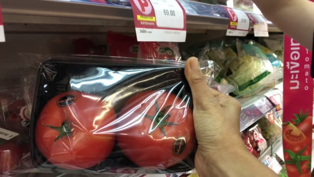 woman's hand shopping fresh organic food in supermarket , tomato - packet stock videos & royalty-free footage