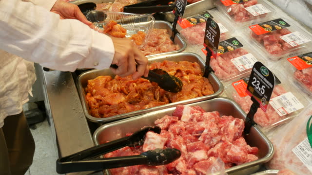 woman's hand shopping fresh organic food in supermarket