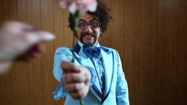 MS Woman's hand taking pink carnation from man in blue suit, Atlanta, Georgia, USA