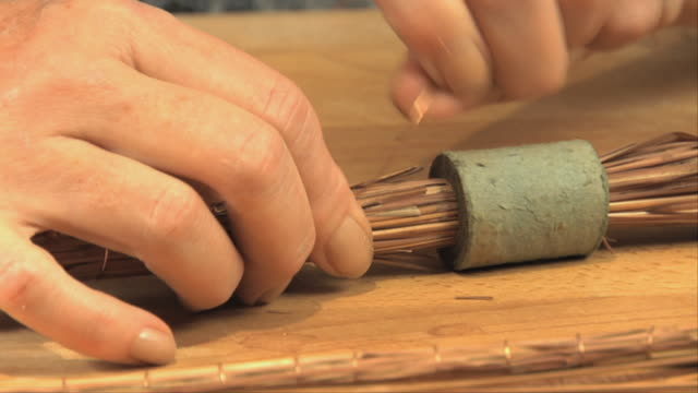 cu woman's hand tying copper wire into display piece / oak park, illinois, usa - copper stock videos & royalty-free footage