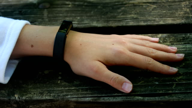 woman's hand using fitbit - fitness tracker stock videos and b-roll footage