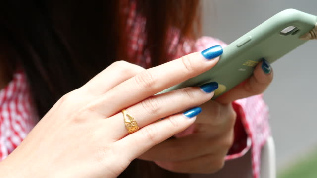 woman's hand using smartphone , close up