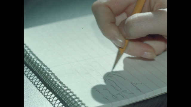 woman's hand writes shorthand - film stock videos & royalty-free footage