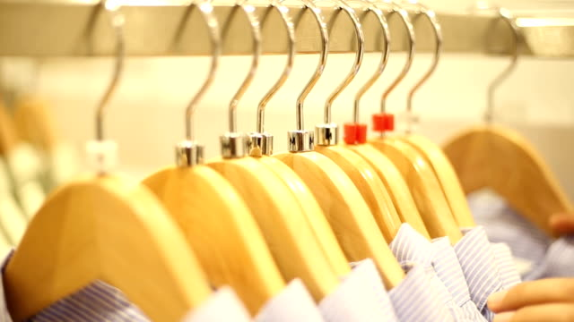 woman's hands choosing clothes. - differential focus stock videos & royalty-free footage