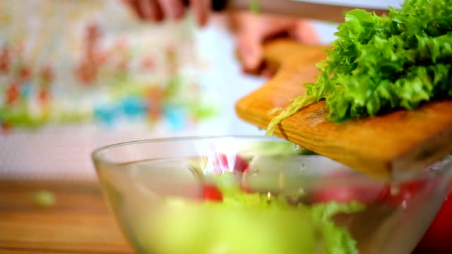 woman's hands cutting lettuce - salad bowl stock videos & royalty-free footage